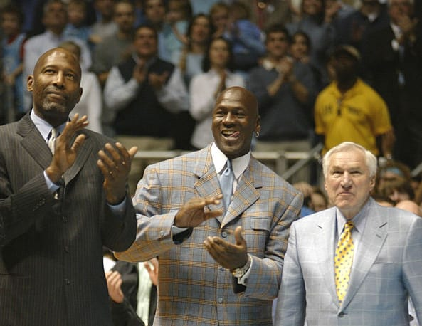 James Worthy, Michael Jordan and Dean Smith at a UNC Basketball game. Feb. 10, 2007. By 2007, Smith was suffering from dementia and often forgot the names of his former players. But his wife Linnea Smith said he always recognized they were people he knew and who cared about him. Photo credit: Zeke Smith, Wikimedia Creative Commons