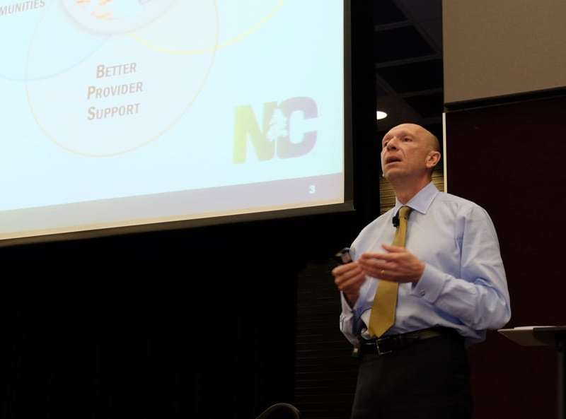 Health and Human Services Secretary Rick Brajer gives a rundown of the draft Medicaid reform proposal Wednesday evening at the McKimmon Center on the NC State University campus in Raleigh.