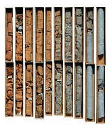 Core samples allow geologists to study underground soil and rock compositions. In U.S. Geological Survey core segments, extracted at the Langtree Peninsula research station in North Carolina, surface soil is visible in the upper left. Bedrock, from more than 50 feet underground, is at right.