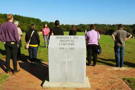 City of Raleigh employee Kate Pearce leads a tour to the Dorothea Dix Hospital property Sunday morning as part of the Lives on the Hill memorial presentations. Photo credit: Karen Tam