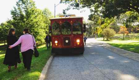 Karen Dunn and Jenny Gadd walk to a trolley used for tours of the future Dix park on Sunday morning. The tours were given as part of the Lives on the Hill event which sought to generate conversation and ideas about a memorial on the property. Photo credit: Karen Tam