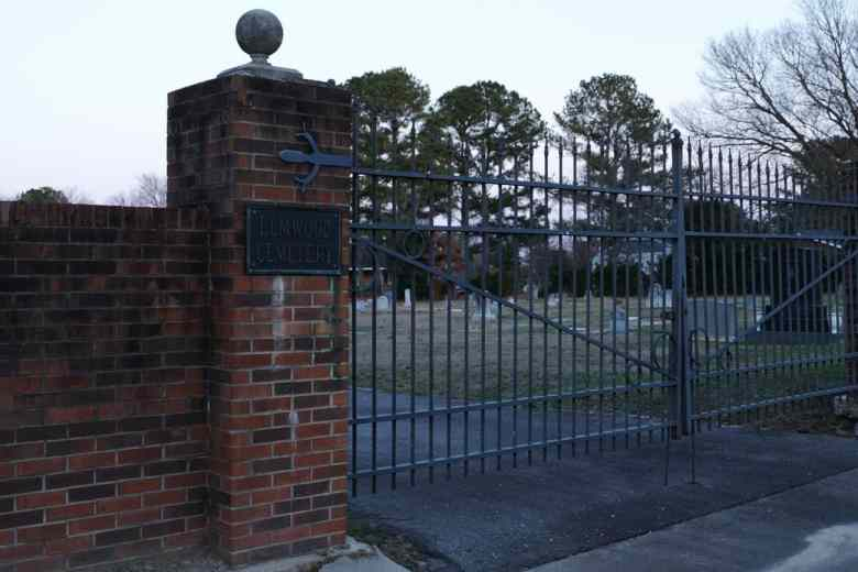 Shows a cemetery gate that's about 8' tall before reaching the finials.
