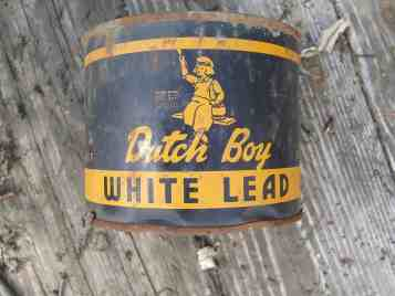 """Shows old can of Dutch Boy, """"White LEad"""" paint"""