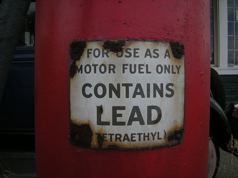 """old paint can reading """"Contains Lead"""""""