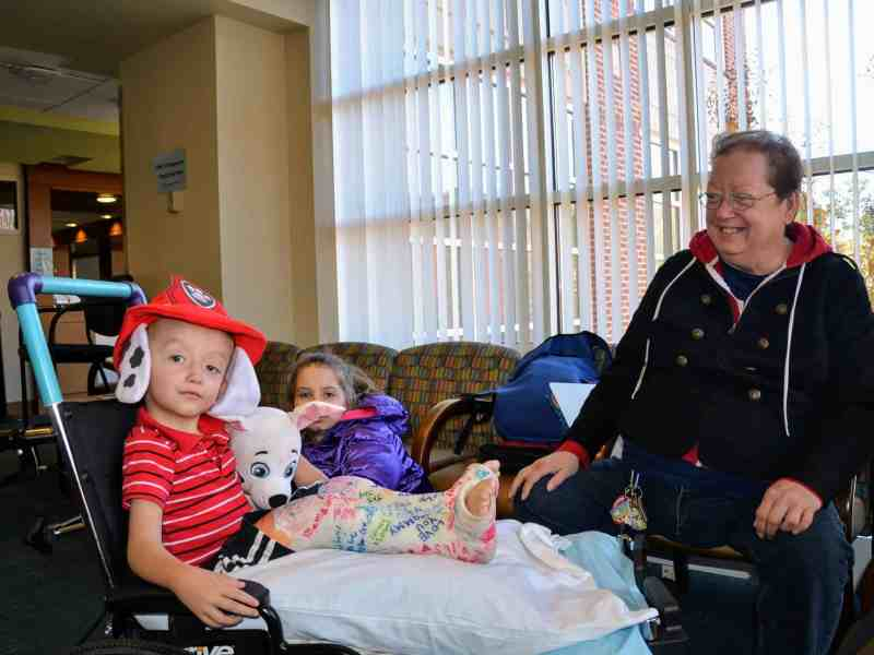 Three-year-old Ryan Sutton rolled into UNC Orthopedics holding his stuffed dog Marshall, wearing his firefighter PAW Patrol hat and double leg casts.