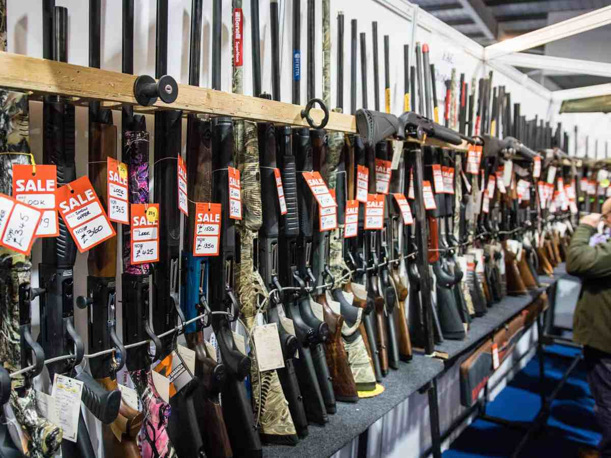 shows a rack of rifles. They're part of the debate over red flag laws.
