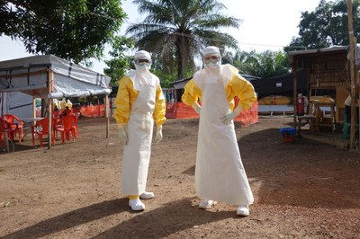 Fischer and a colleague suited up for full infection control during the 2014 West Africa Ebola outbreak.