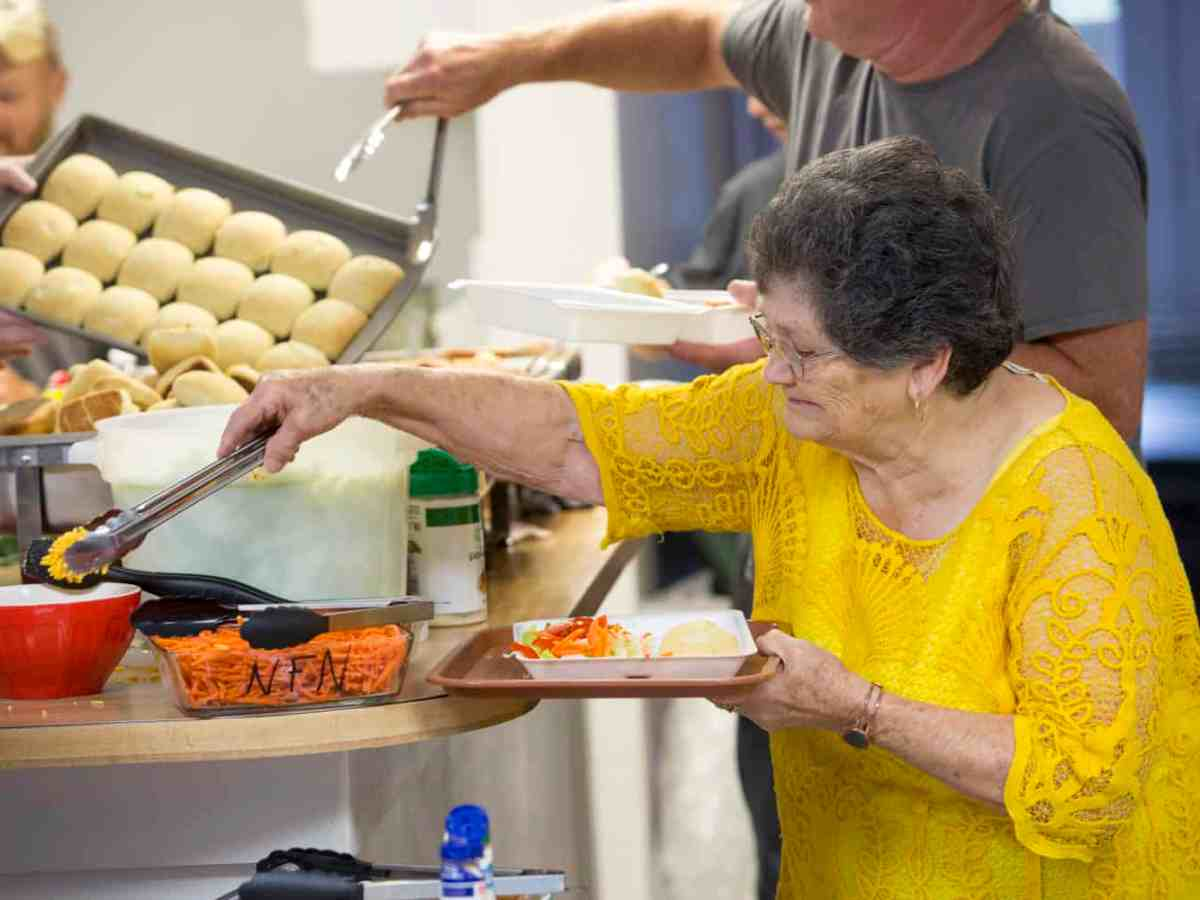 Seniors experiencing food insecurity eat at a church supper.