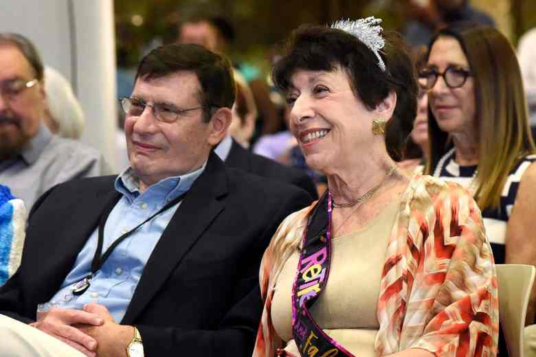 Linda Birnbaum wearing a tiara, has a laugh as she looks over her shoulder.