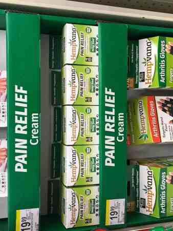 a display of hemp-based pain relief and other health aids in a pharmacy