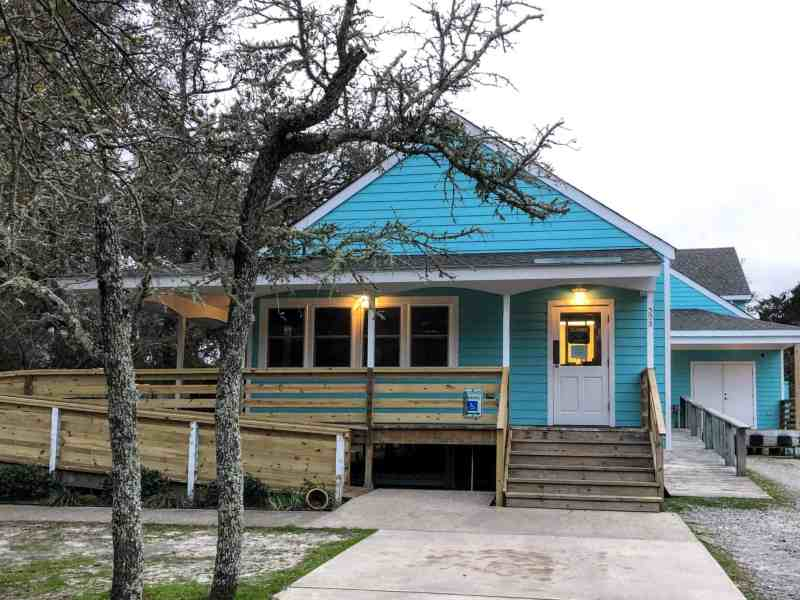 A blue structure houses the Ocracoke Health Center