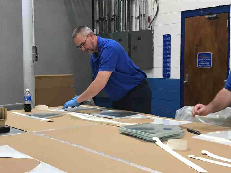 Correction Enterprise staff work on making face shields for prisons during the coronavirus outbreak