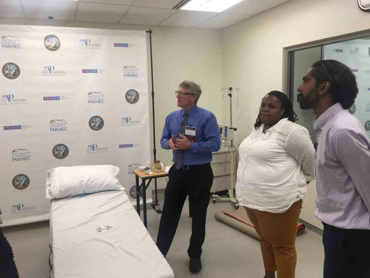 Providers stand around a bed in a training about opioid use disorder at MAHEC in Asheville last year.