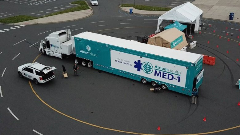 shows a mobile hospital that's being deployed for COVID treatment