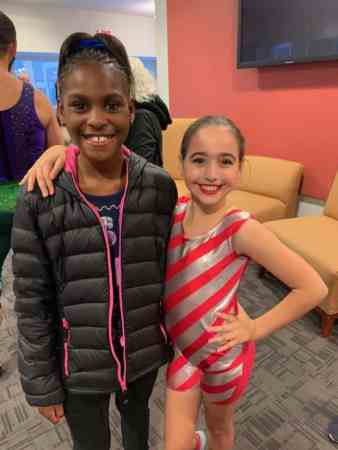 the photo shows two young girls posing with their arms around each other. Friends Evan and Vivien haven't been able to spend time together because of COVID-19