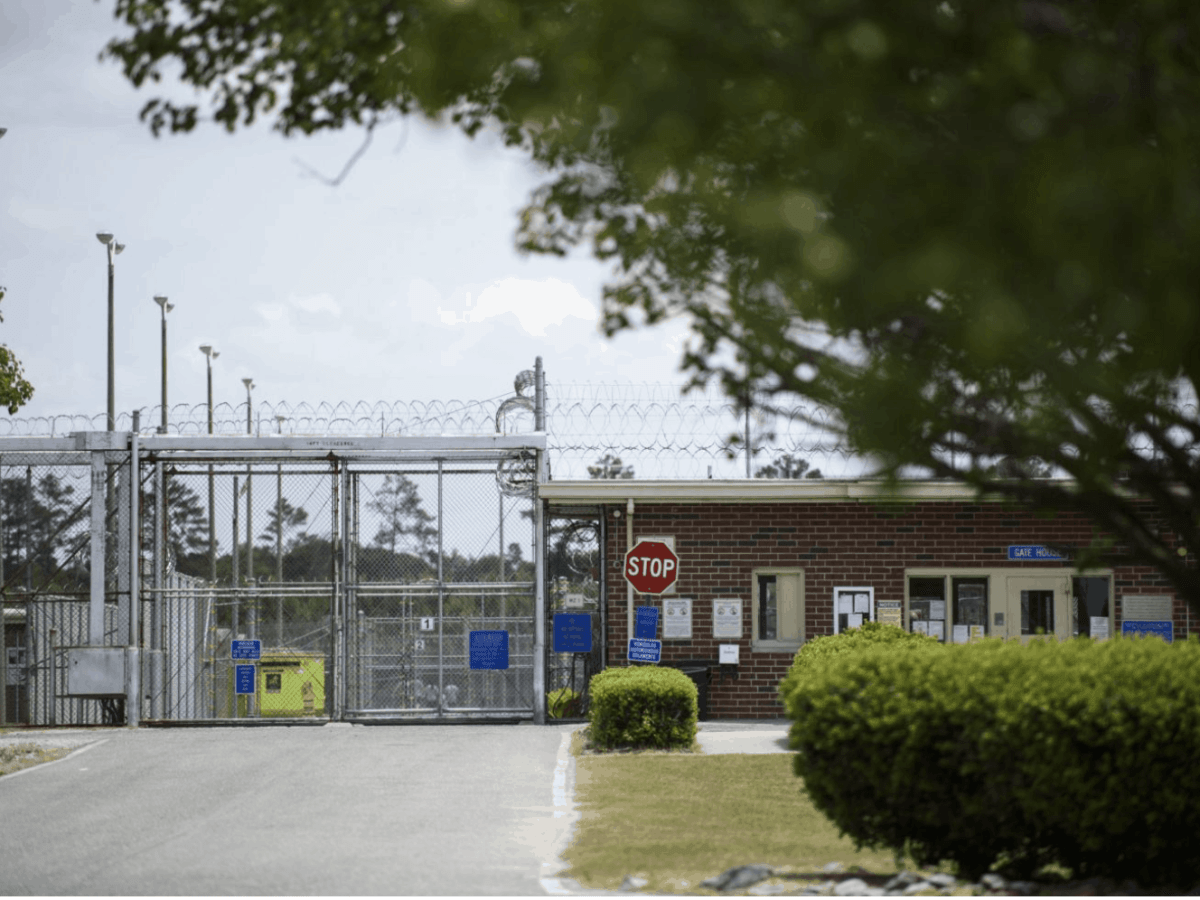 We see a gated entrance to Neuse Correctional Institution located in Goldsboro. The facility has had hundreds of inmates test positive for COVID-19, including several who have died.