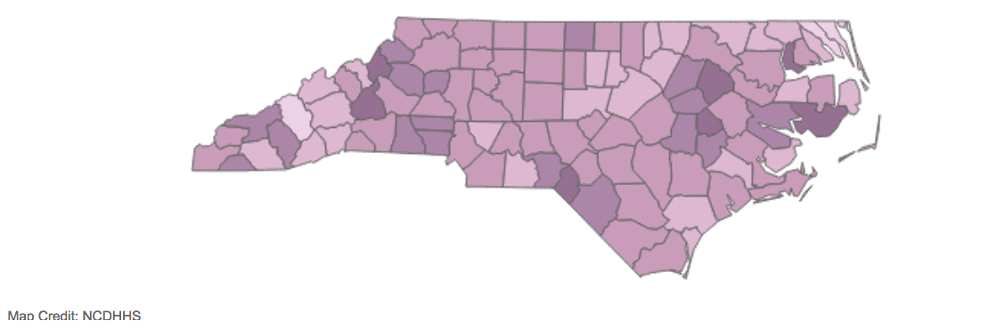 shows a county map of north carolina with darker counties being places with higher rates of COVID-19. The darkest counties right now are all rural.