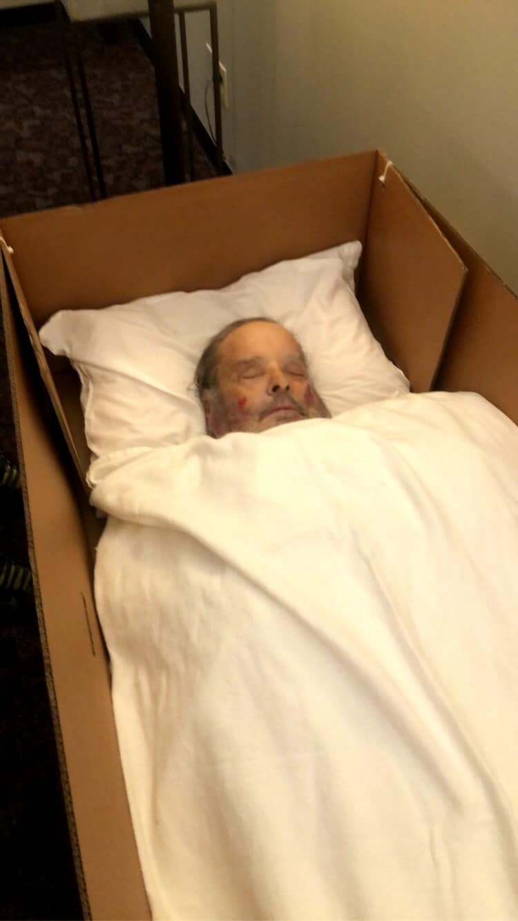 We see the body of Roy Hood, a 66-year-old who died of COVID-19 and was a prisoner at Greene Correctional Institution, lying in a cardboard box at a funeral home. He is about to be cremated.