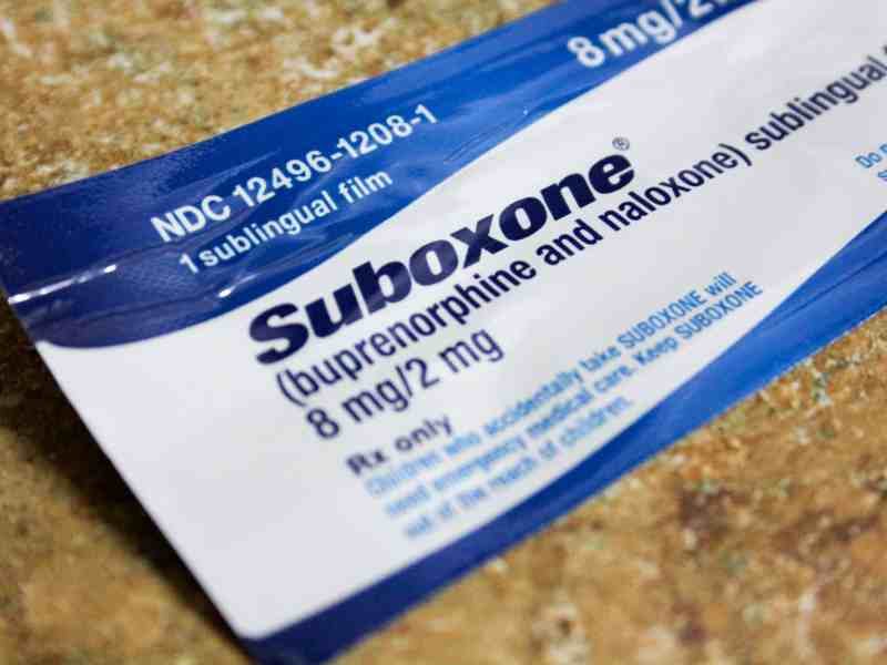 A wrapped strip of suboxone is on a counter.