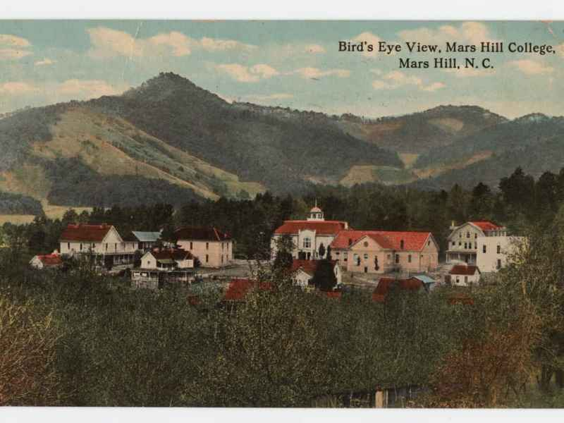 an old postcard shows several red and white buildings nestled among mountains covered in trees. Several Western NC colleges like Mars Hill avoided large COVID outbreaks on campus