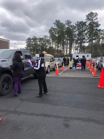 Cars in a line at the drivethru vaccine clinic