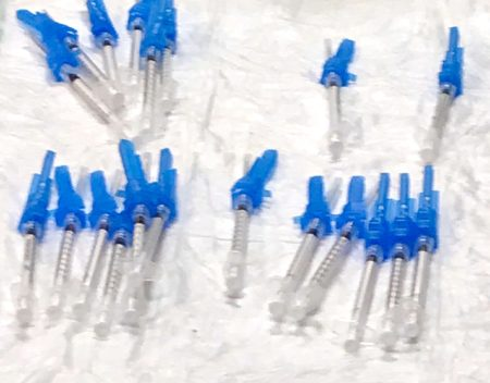 Blue and white syringes for Pfizer vaccine