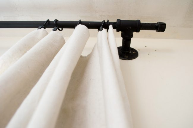 pipe curtain rod with drop cloth curtain panel