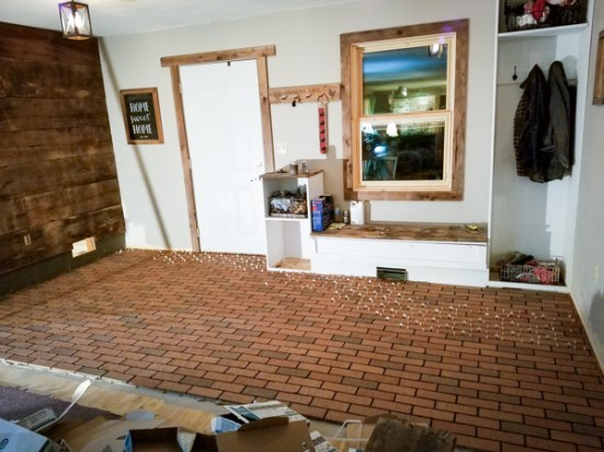 laying interior brick tile and placing spacers between tiles