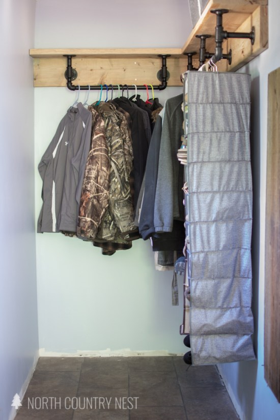 industrial closet storage in laundry room closet with hanging shoe rack