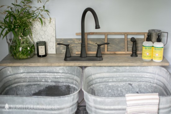 industrial style laundry room renovation reveal
