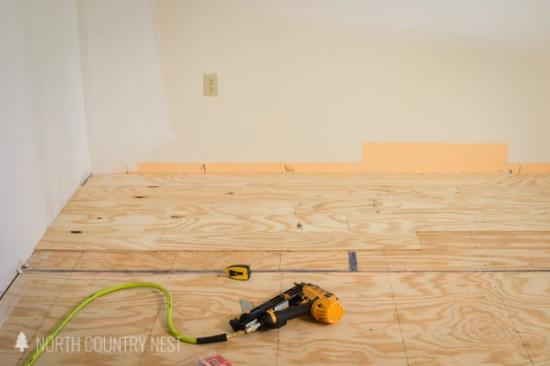using an air gun to install plywood flooring