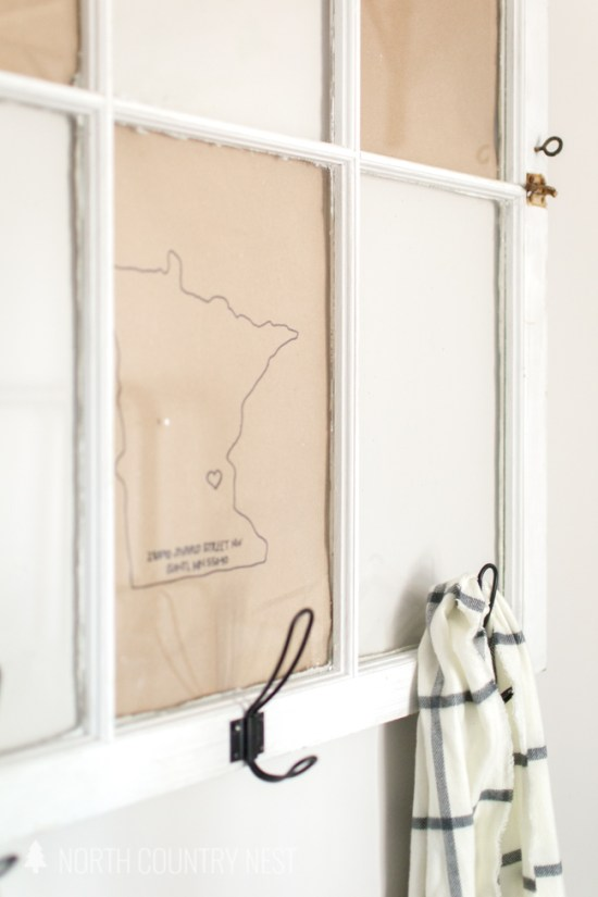 How to Repurpose an Old Window into a Guest Bedroom Coat Hanger
