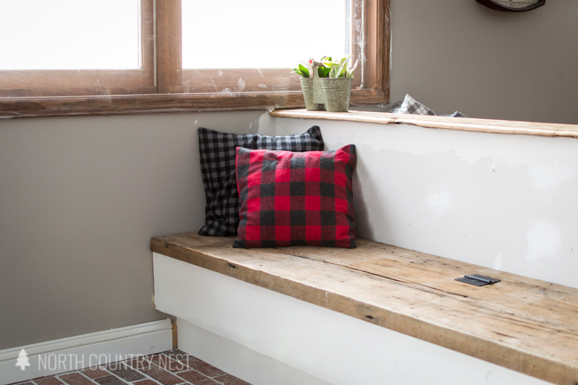 entryway bench with rustic flannel pillows