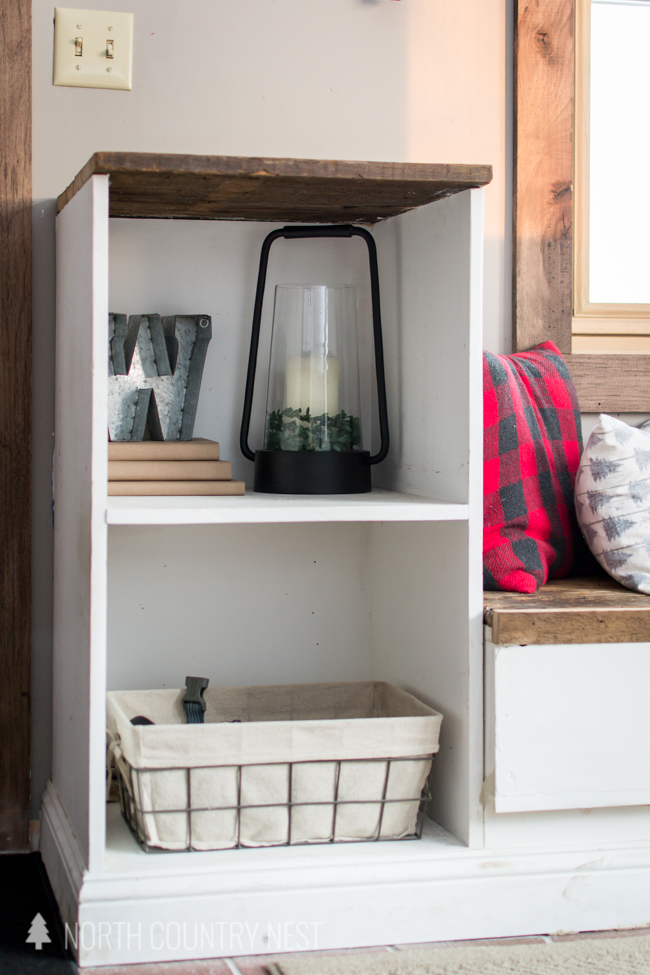 entryway built in shelves with black lantern