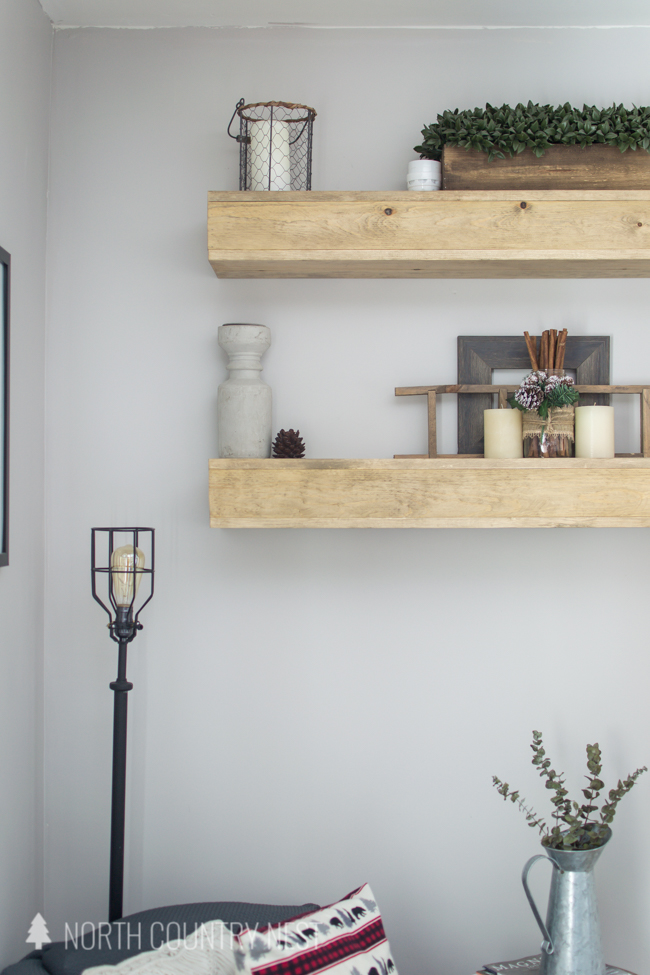 floating shelving in guest bedroom with winter decor