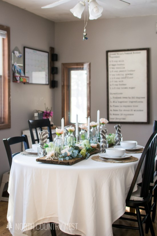 rustic kitchen with table set with spring theme