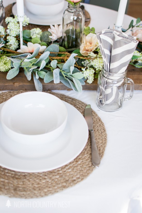 white dishes on natural fiber charger