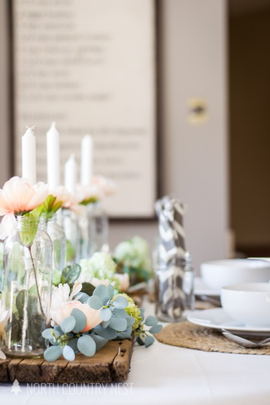 rustic, simple and romantic spring tablescape with eucalyptus and pink flowers