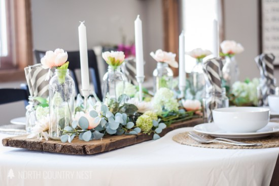 white candle sticks and rustic wood table runner