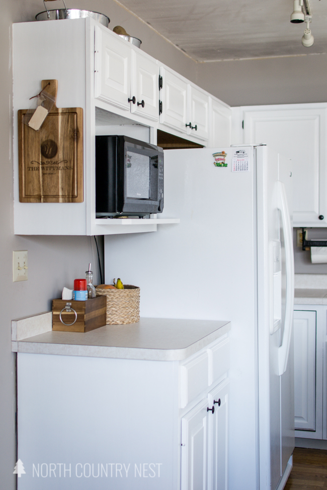 white kitchen cabinets with white fridge