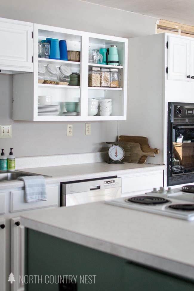 white, open kitchen cabinet