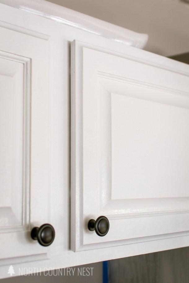 matte black kitchen cabinet hardware with white cabinets