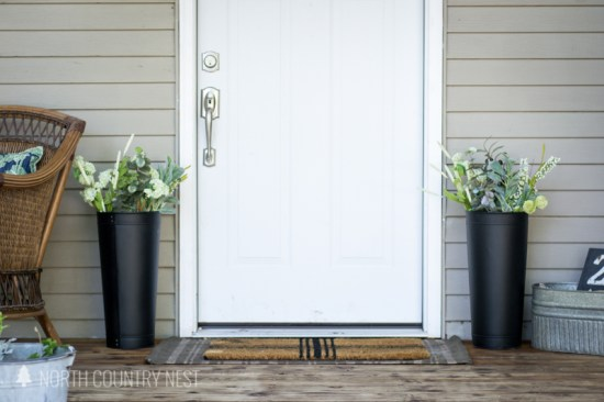 black planters with faux flower stems