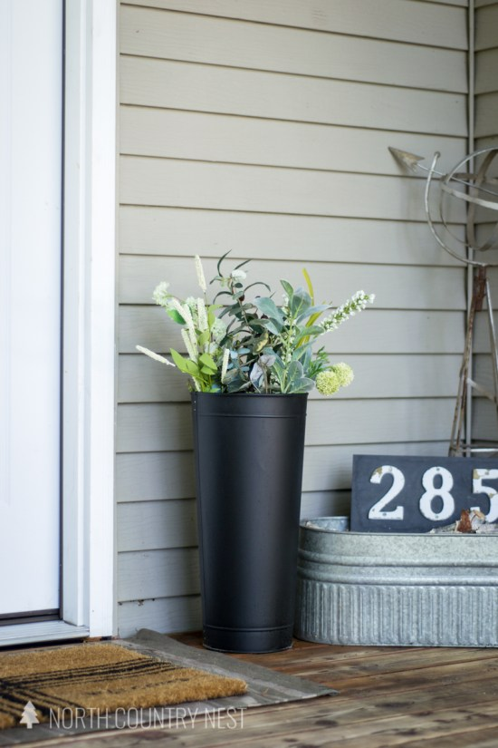 black vase and galvanized tub for simple porch decor