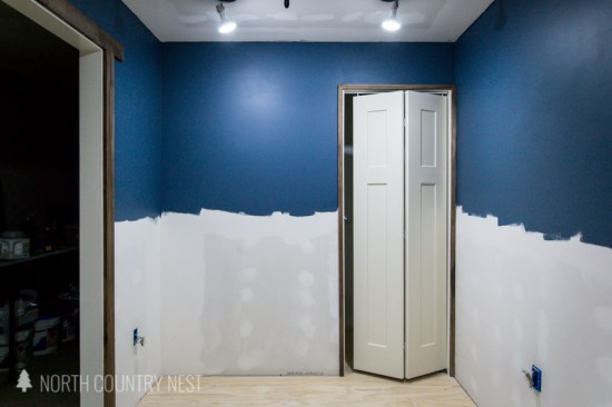 blue walls with dark wood trim in home office