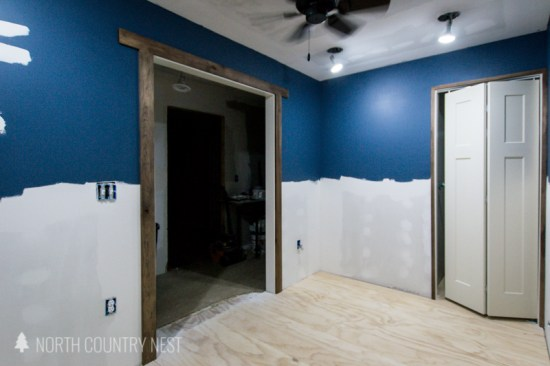 half blue walls with dark trim in office