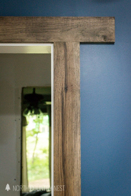 wide plank trim around doorway with blue painted walls in home office