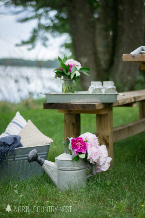 galvanized watering can filled with peonies