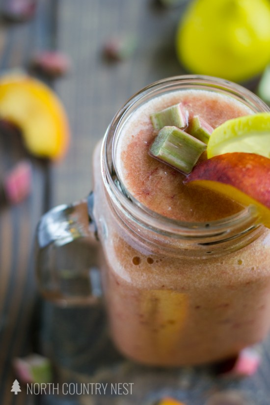 peach rhubarb smoothie on wooden background