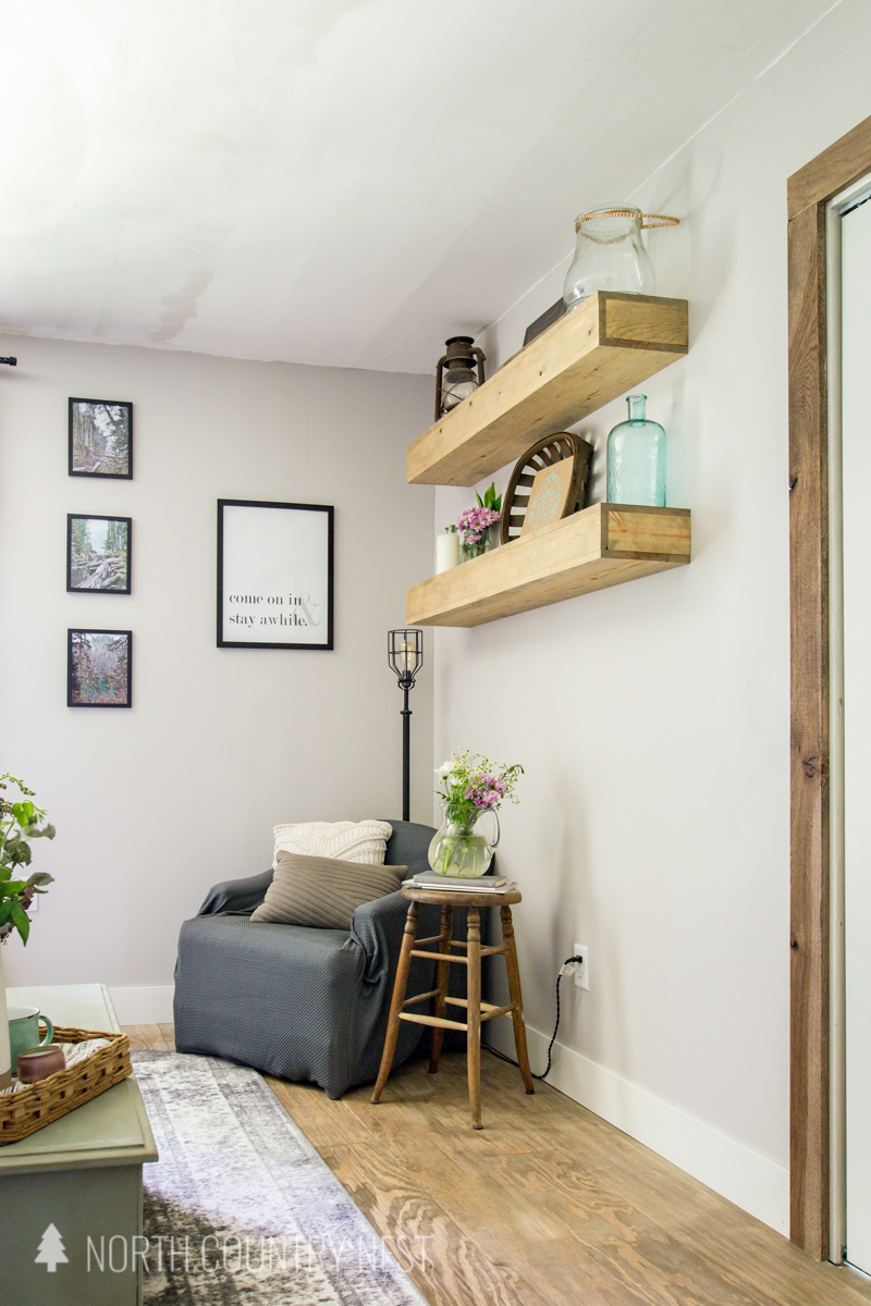 reading nook with styled floating shelves